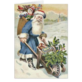 サンタクロースの手押し車の常緑樹はキャンデーをもてあそびます カード