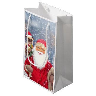 サンタクロースwのクリスマスのギフトのパグ犬 スモールペーパーバッグ