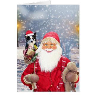 サンタクロースwのクリスマスのギフトのボーダーコリー犬 グリーティングカード