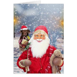 サンタクロースwのクリスマスのギフトのラブラドール犬 グリーティングカード