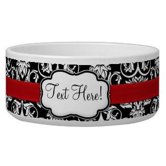シックで黒くか白いダマスク織の赤のリボン