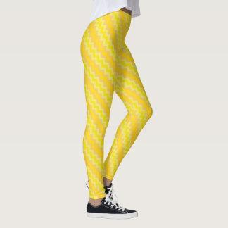 シックなラッパスイセンの黄色およびオレンジシェブロンパターン レギンス