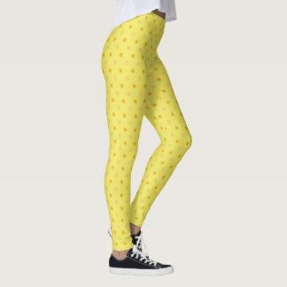 シックなラッパスイセンの黄色およびオレンジ水玉模様パターン レギンス