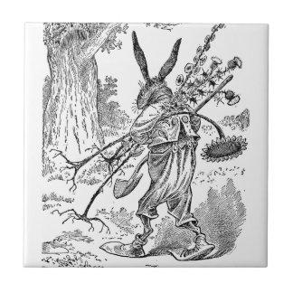 シャベル及び根こそぎにされた植物を持つウサギの庭師 タイル