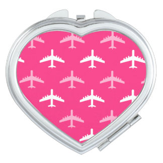 ショッキングピンクおよび白い飛行機