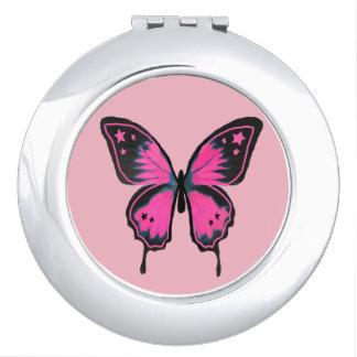 ショッキングピンクのコンパクトの蝶鏡