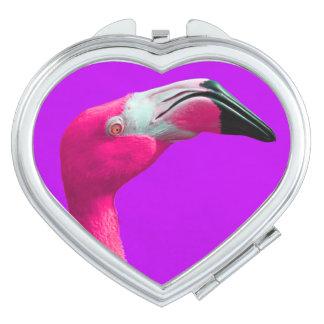 ショッキングピンクのフラミンゴが付いているハート形の密集した鏡