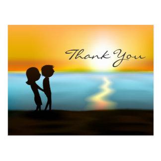 シルエットのカップルの日没の~の日の出のビーチは感謝していしています ポストカード