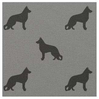 ジャーマン・シェパード犬はパターンのシルエットを描きます ファブリック