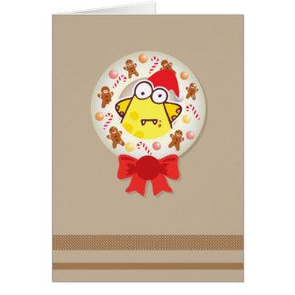 ジンジャーブレッドマンが付いているクリスマスのリース カード