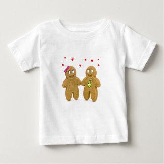 ジンジャーブレッドマンのハートのベビーのTシャツ ベビーTシャツ