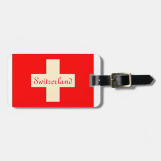 スイスの旗の荷物のラベルを見るヴィンテージ ラゲッジタグ