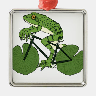 スイレンの浮いている葉の車輪が付いているカエルの乗馬のバイク メタルオーナメント