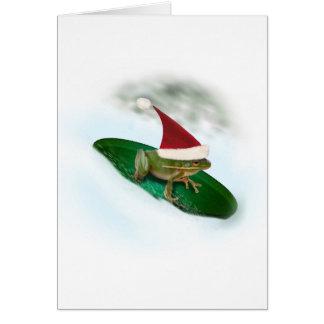 スイレンの浮いている葉の雪を通って紛砕しているカエル カード