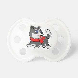 スカーフを持つ漫画のハスキーな子犬 おしゃぶり
