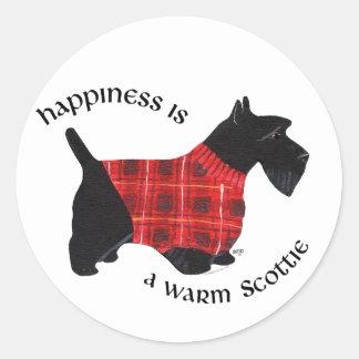 スコットランドテリアの赤く及び黒い格子縞のセーター ラウンドシール