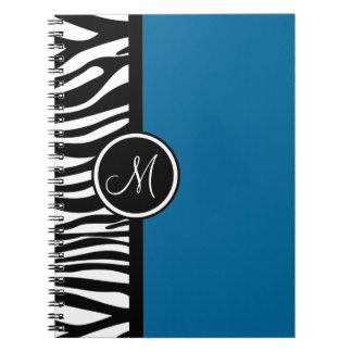 スタイリッシュなシマウマのプリントのターコイズのモノグラムのノート ノートブック
