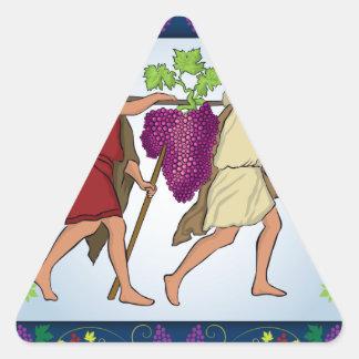 スパイの後でブドウを渡しているジョシュアおよびCaleb 三角形シール
