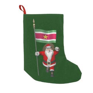 スリナムの旗を持つサンタクロース スモールクリスマスストッキング
