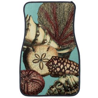 ターコイズの貝および赤い珊瑚のコレクション カーマット
