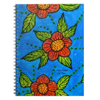 ターコイズの赤い花が付いている写真のノート ノートブック
