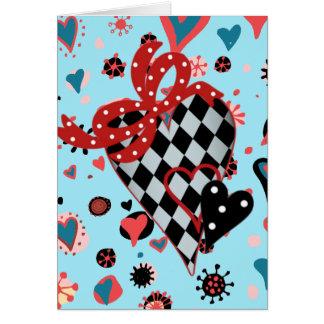 チェッカーボードの黒および赤いハート カード