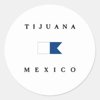 ティフアナメキシコのアルファ飛び込みの旗 ラウンドシール