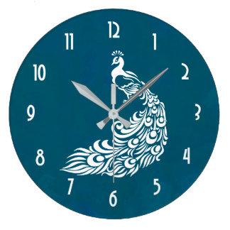 ティール(緑がかった色)のはっきりしたでスタイリッシュなアールデコのデザインの白い孔雀 ラージ壁時計
