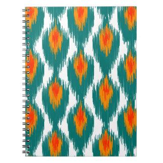 ティール(緑がかった色)のオレンジの抽象芸術の種族のイカットのダイヤモンドパターン ノートブック