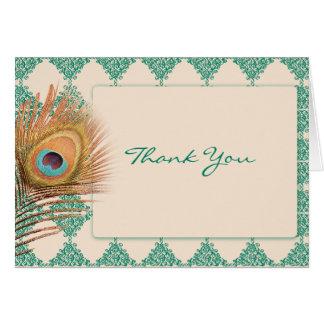 ティール(緑がかった色)のモロッコのタイルの孔雀の羽は感謝していしています カード