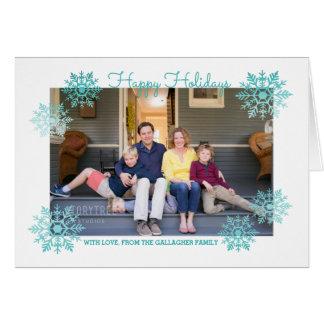 ティール(緑がかった色)の揺らめくシックな雪片の休日の写真 カード