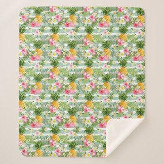 ティール(緑がかった色)の熱帯花及びパイナップルは縞で飾ります シェルパブランケット