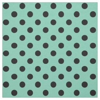 ティール(緑がかった色)の緑の水玉模様の黒 ファブリック