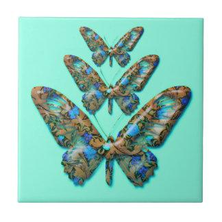 ティール(緑がかった色)の緑の装飾的なタイルの抽象的な蝶 タイル