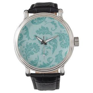 ティール(緑がかった色)の華麗さのターコイズのダマスク織の花模様の壁紙 腕時計
