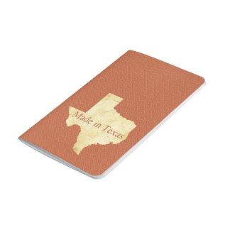 テキサス州の錆ついた赤い小型ジャーナルで作られる ポケットジャーナル