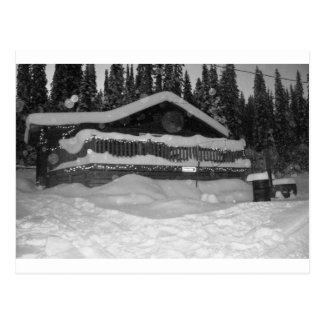 デッキを離れて滴る冬の小屋の雪 ポストカード