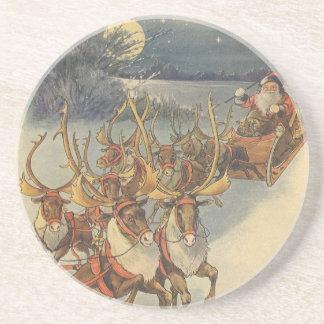 トナカイが付いているヴィンテージのクリスマスのサンタクロースのそり コースター