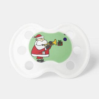 トランペットを演奏するおもしろいなクリスマスサンタ おしゃぶり