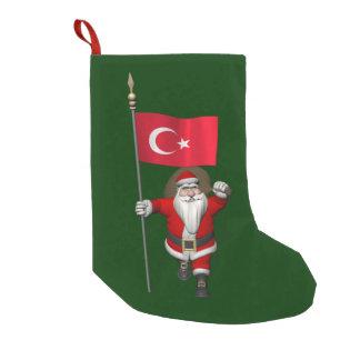 トルコの旗を持つおもしろいなサンタクロース スモールクリスマスストッキング