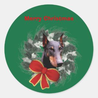 ドーベルマン犬およびリースのクリスマスの休日のステッカー ラウンドシール