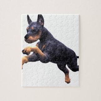ドーベルマン犬の子犬の跳躍 ジグソーパズル
