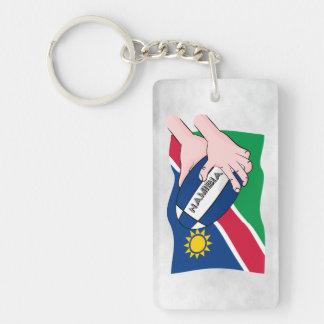 ナミビアの旗のラグビーのボールの漫画手 キーホルダー
