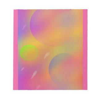 ネオンの抽象的な日没および惑星40はメモ帳のページを捲ります ノートパッド