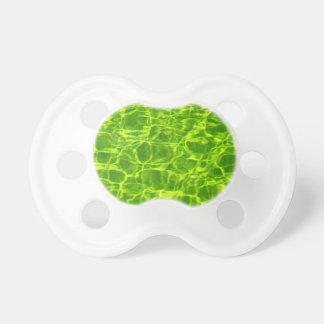 ネオン緑水パターン背景のブランクのモダン おしゃぶり