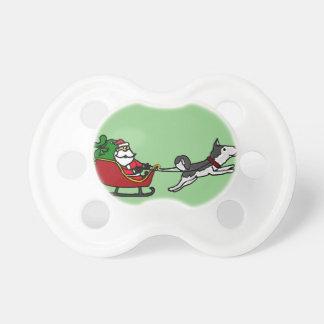 ハスキーな犬の引きのおもしろいなクリスマスのそり おしゃぶり
