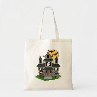 ハロウィンのかわいいお化け屋敷および小さい魔法使いは袋に入れます トートバッグ
