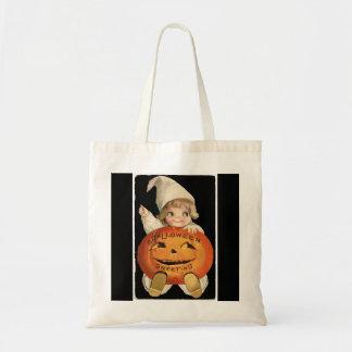 ハロウィンの大きいカボチャを持つヴィンテージの小さな女の子 トートバッグ