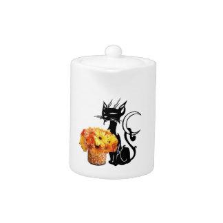 ハロウィンの黒猫およびキャンデートウモロコシ