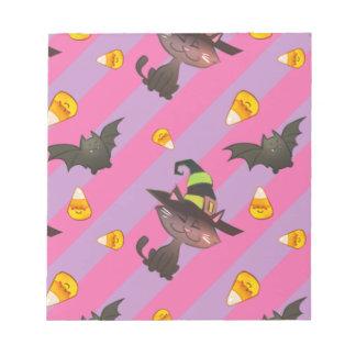 ハロウィン幸せで小さいこうもりおよび猫 ノートパッド